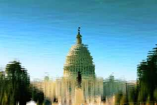 photo of the U.S. Capitol dome reflected in water